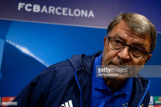 Olympiacos' head coach Takis Lemonis arrives to give a press conference in Barcelona on October 17 2017 on the eve of the UEFA Champions League...