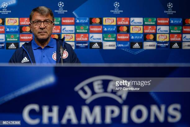 Olympiacos' head coach Takis Lemonis gives a press conference in Barcelona on October 17 2017 on the eve of the UEFA Champions League football match...