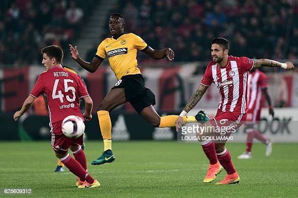 Olympiacos Piraeus' French defender Manuel da Costa vies with BSC Young Boys' Denis Zakaria during the UEFA Europa League football match between...