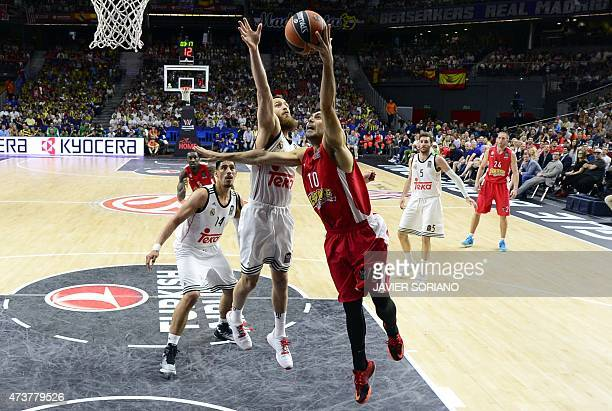 Olympiacos Piraeus' guard Kostas Sloukas vies with Real Madrid's guard Sergio Rodriguez during the Euroleague Final Four basketball match final...