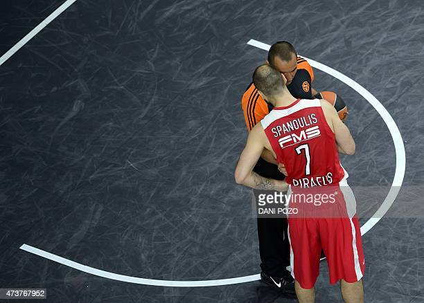 Olympiacos Piraeus' guard Vassilis Spanoulis talks with the referee during the Euroleague Final Four basketball match final between Real Madrid and...