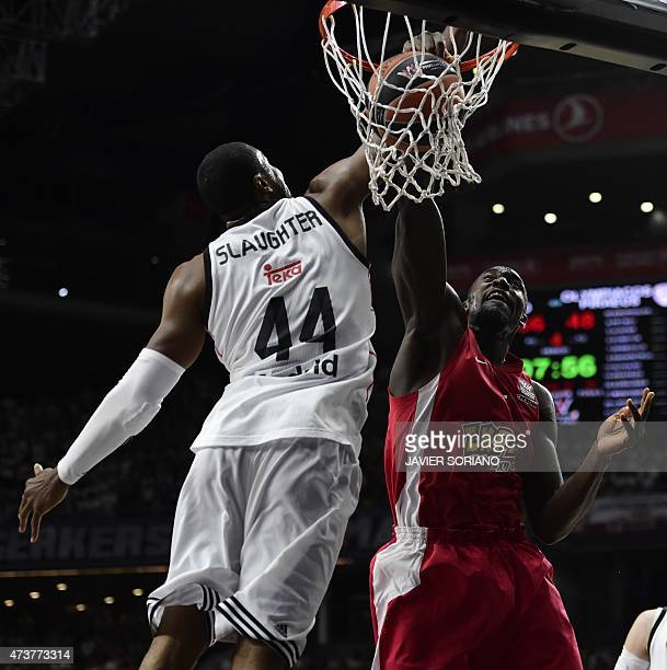 Olympiacos Piraeus' US forward Othello Hunter vies with Real Madrid's US forward Marcus Slaughter during the Euroleague Final Four basketball match...