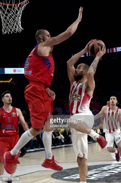 Olympiacos Piraeus Vassilis Spanoulis vies with CSKA Moscow James Augustine during the semifinal basketball match between Olympiacos Piraeus and CSKA...