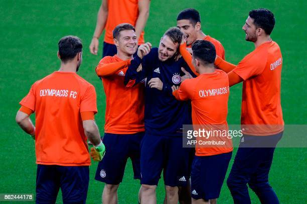Olympiacos' players take part in a training session at the Camp Nou stadium in Barcelona on October 17 2017 on the eve of the UEFA Champions League...
