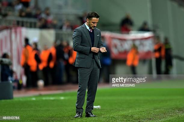 Olympiacos' Portuguese head coach Vitor Pereira reacts during the UEFA Europa League Round of 32 football match Olympiacos FC vs FK Dnipro in Athens...