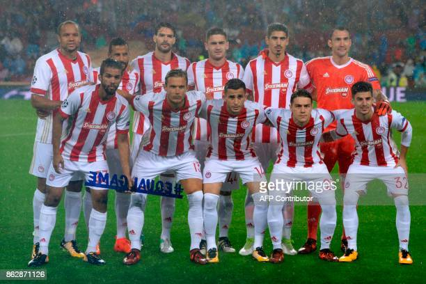 Olympiacos team line up before the UEFA Champions League group D football match FC Barcelona vs Olympiacos FC at the Camp Nou stadium in Barcelona on...