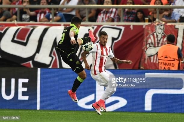 Olympiacos's defender Diogo Figueiras fights for the ball with Sporting Lisbon' midfielder Marcos Acuña during the Group D UEFA Champions League...