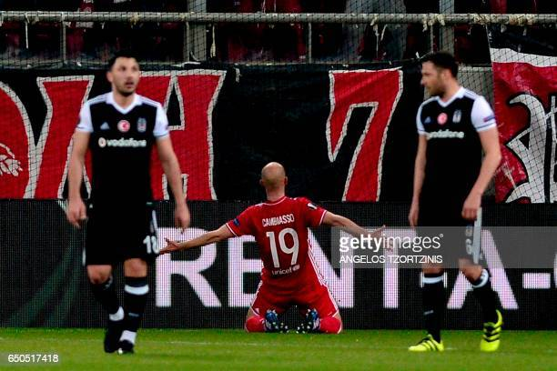 Olympiakos' Argentinian midfielder Esteban Cambiasso celebrates after scoring a goal during the UEFA Europa League round of 16 first leg football...
