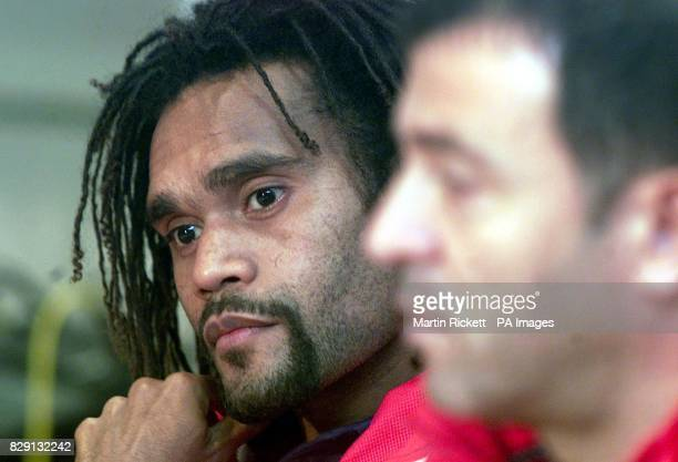 Olympiakos' Chrisian Karembeu with coach Takis Lemonis talk to the media at a press conference before thier Champions League match with Manchester...