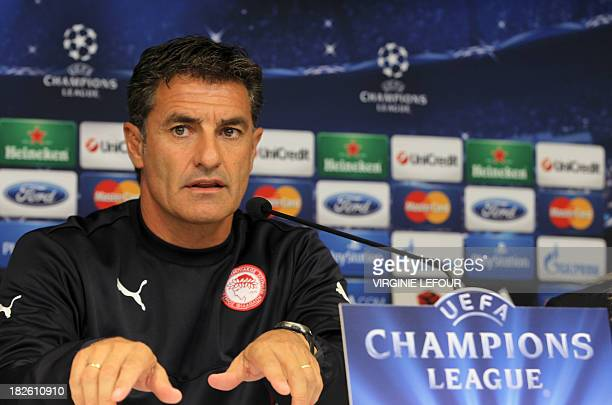 Olympiakos football team's coach Jose Miguel Gonzalez Martin del Campo speaks during a press conference on October 1 in Brussels on the eve of his...