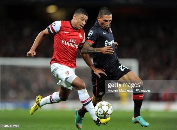 Olympiakos' Jose Holebas and Arsenal's Alex OxladeChamberlain battle for the ball