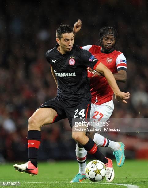 Olympiakos' Kostas Manolas and Arsenal's Yao Gervinho battle for the ball