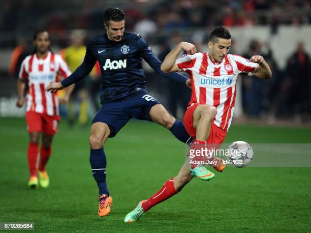 Olympiakos' Kostas Manolas and Manchester United's Robin Van Persie battle for the ball