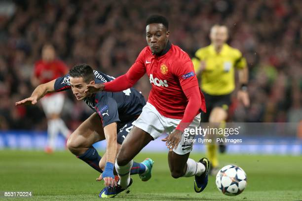 Olympiakos' Kostas Manolas brings down Manchester United's Danny Welbeck to earn himself an early yellow card