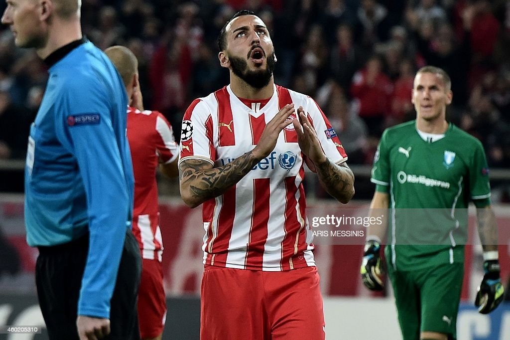 Olympiakos' <a gi-track='captionPersonalityLinkClicked' href=/galleries/search?phrase=Kostas+Mitroglou&family=editorial&specificpeople=2203870 ng-click='$event.stopPropagation()'>Kostas Mitroglou</a> (C) reacts during the UEFA Champions League Group A football match Olympiakos vs Malmo FF at the Karaiskaki stadium near Athens on December 9, 2014.
