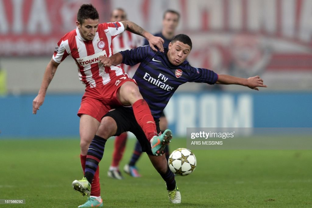 Olympiakos' Leandro Greco (L) fights for the ball with Arsenal's Francis Coquelin during their group B Champions League football game at the Karaiskaki stadium in Athens on December 4, 2012.