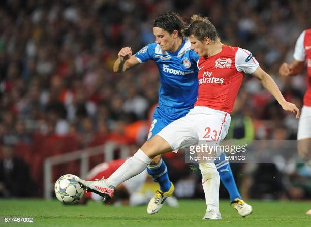 Olympiakos' Lubomir Fejsa and Arsenal's Andrei Arshavin battle for the ball