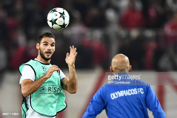 Olympiakos' midfielder Panagiotis Tachtsidis warms up prior to the UEFA Champions League group D football match between FC Barcelona and Olympiakos...