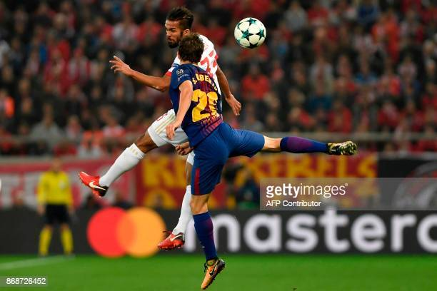 Olympiakos' Moroccan midfielder Mehdi CarcelaGonzalez vies with Barcelona's Spanish midfielder Sergi Roberto during the UEFA Champions League group D...