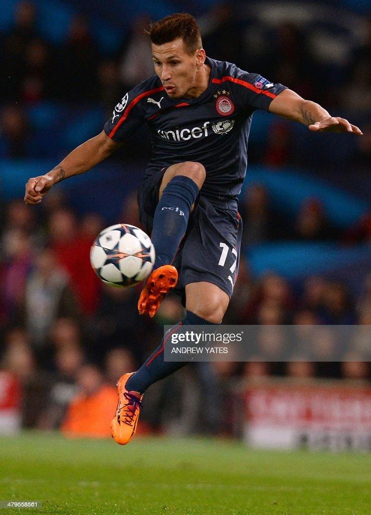 Olympiakos' Paraguayan midfielder Hernan Perez controls the ball during the UEFA Champions League round of 16 second leg football match between...