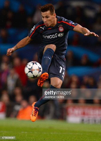 Olympiakos' Paraguayan midfielder Hernan Perez controls the ball during the UEFA Champions League round of 16 second leg football match between...