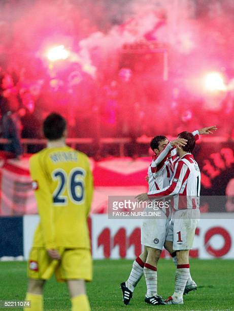 Olympiakos Piraeus' players celebrate a goal vs France's Sochaux during their UEFA Cup qualifying football match held in Athens 17 February 2005 AFP...