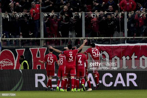 Olympiakos' players celebrate a goal during the UEFA Europa League round of 16 first leg football match between Olympiakos Piraeus and Besiktas in...