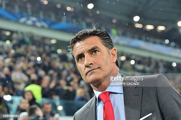 Olympiakos' Spanish coach Michel looks on prior the Champions League Group A football match Juventus vs Olympiacos during the UEFA Champions League...