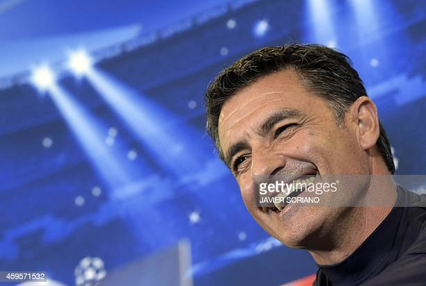 Olympiakos' Spanish coach Michel smiles during a press conference at the Vicente Calderon stadium in Madrid on November 25 on the eve of the UEFA...