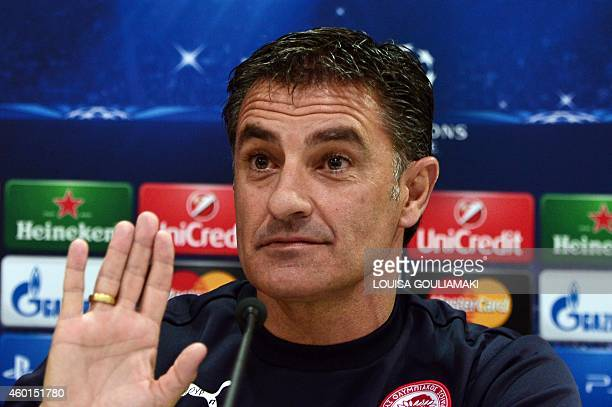 Olympiakos' Spanish coach Michel speaks during a press conference on the eve on the group A Champions League football match Olympiakos vs Malmo at...
