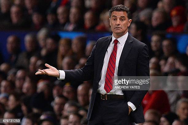 Olympiakos' Spanish manager Michel reacts during the UEFA Champions League round of 16 second leg football match between Manchester United and...