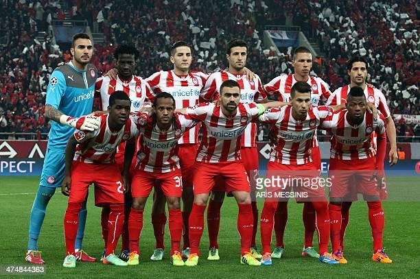 Olympiakos's players Spanish goalie Roberto Congolese midfielder Denvil N'Dinga Greek defender Kostas Manolas Spanish defender Ivan Marcano Greek...