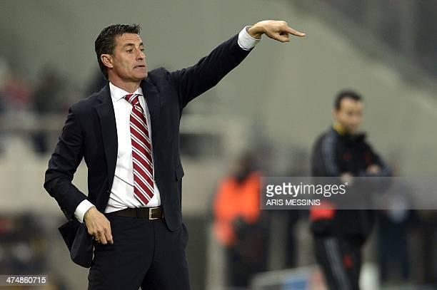 Olympiakos's Spanish coach Michel gestures during the round of 16 Champions League football match Olympiakos vs Manchester United at Karaiskaki...