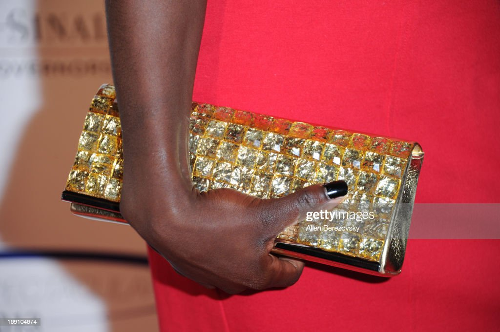 Olympian Dawn Harper (purse detail) arrives at the Sports Spectacular 28th Anniversary Gala at the Hyatt Regency Century Plaza on May 19, 2013 in Century City, California.