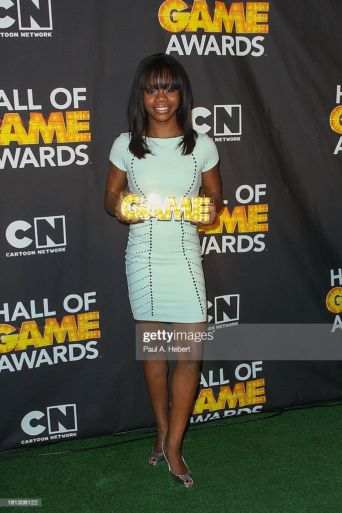 Olympian Gabby Douglas poses in the press room during the 3rd Annual Cartoon Network's 'Hall Of Game' Awards held at Barker Hangar on February 9, 2013 in Santa Monica, California.