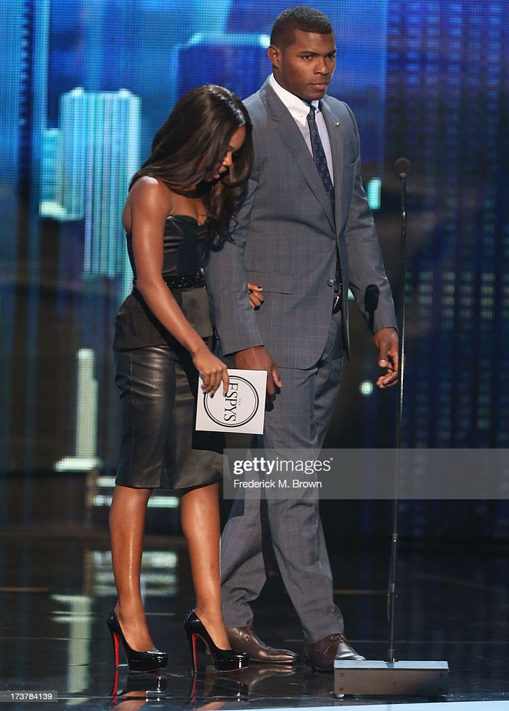 Olympian Gabrielle Douglas and MLB player <a gi-track='captionPersonalityLinkClicked' href=/galleries/search?phrase=Yasiel+Puig&family=editorial&specificpeople=10484087 ng-click='$event.stopPropagation()'>Yasiel Puig</a> onstage at The 2013 ESPY Awards at Nokia Theatre L.A. Live on July 17, 2013 in Los Angeles, California.