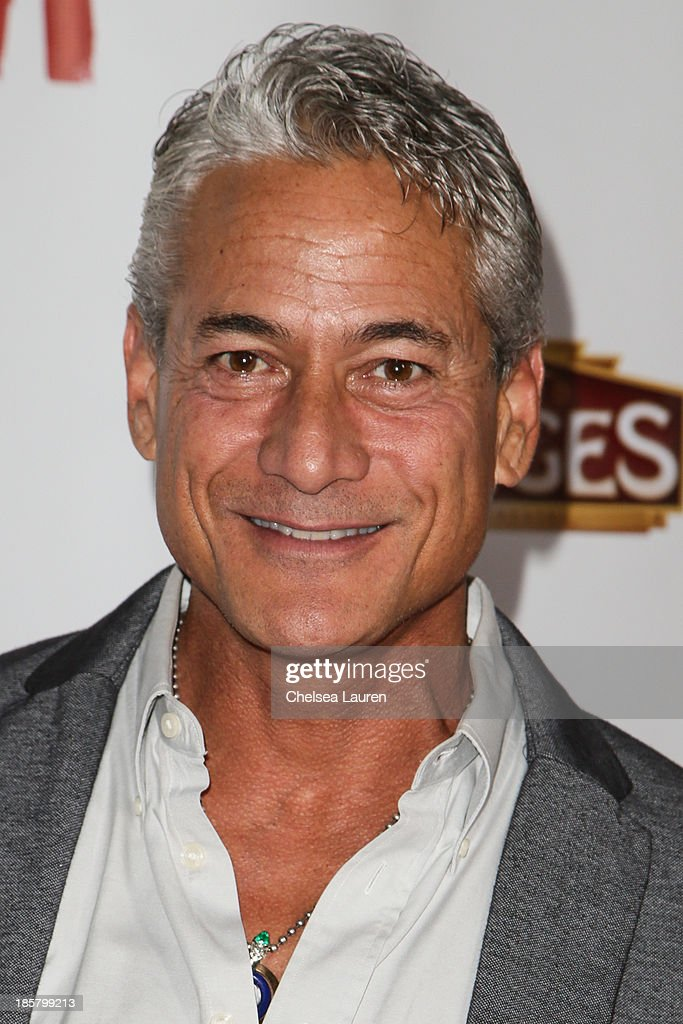 Olympian <a gi-track='captionPersonalityLinkClicked' href=/galleries/search?phrase=Greg+Louganis&family=editorial&specificpeople=217786 ng-click='$event.stopPropagation()'>Greg Louganis</a> arrives at the opening night red carpet for 'Evita' at the Pantages Theatre on October 24, 2013 in Hollywood, California.