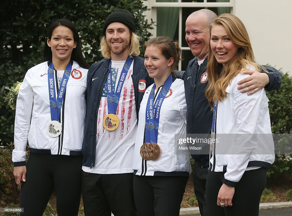 U.S. Olympian <a gi-track='captionPersonalityLinkClicked' href=/galleries/search?phrase=Julie+Chu&family=editorial&specificpeople=677214 ng-click='$event.stopPropagation()'>Julie Chu</a>, Olympian Sage Kostenberg, Paralympian <a gi-track='captionPersonalityLinkClicked' href=/galleries/search?phrase=Stephanie+Jallen&family=editorial&specificpeople=5784669 ng-click='$event.stopPropagation()'>Stephanie Jallen</a>, Paralympian Jon Lujan, and Olympian Mikaela Shifrin stand together while speaking to the media in front of the West Wing while visiting the White House on April 3, 3014 in Washington, DC. President Barack Obama and first lady Michelle Obama welcomed and congratulated the Olympians and Paralympians on their performance and thanked them for representing the United States during the 2014 Olympic Winter Games in Sochi, Russia.