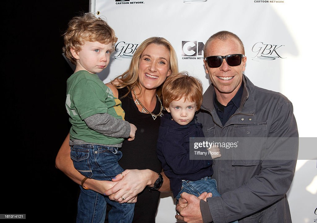 Olympian Kerri Walsh and <a gi-track='captionPersonalityLinkClicked' href=/galleries/search?phrase=Casey+Jennings&family=editorial&specificpeople=228596 ng-click='$event.stopPropagation()'>Casey Jennings</a> pose with their children at the GBK & Cartoon Network's Official Backstage Thank You Lounge at Barker Hangar on February 9, 2013 in Santa Monica, California.