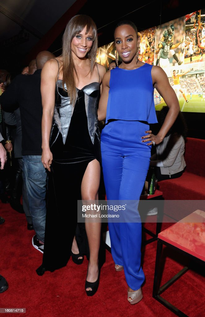 Olympian Lolo Jones and Singer <a gi-track='captionPersonalityLinkClicked' href=/galleries/search?phrase=Kelly+Rowland&family=editorial&specificpeople=201760 ng-click='$event.stopPropagation()'>Kelly Rowland</a> attend ESPN The Magazine's 'NEXT' Event at Tad Gormley Stadium on February 1, 2013 in New Orleans, Louisiana.