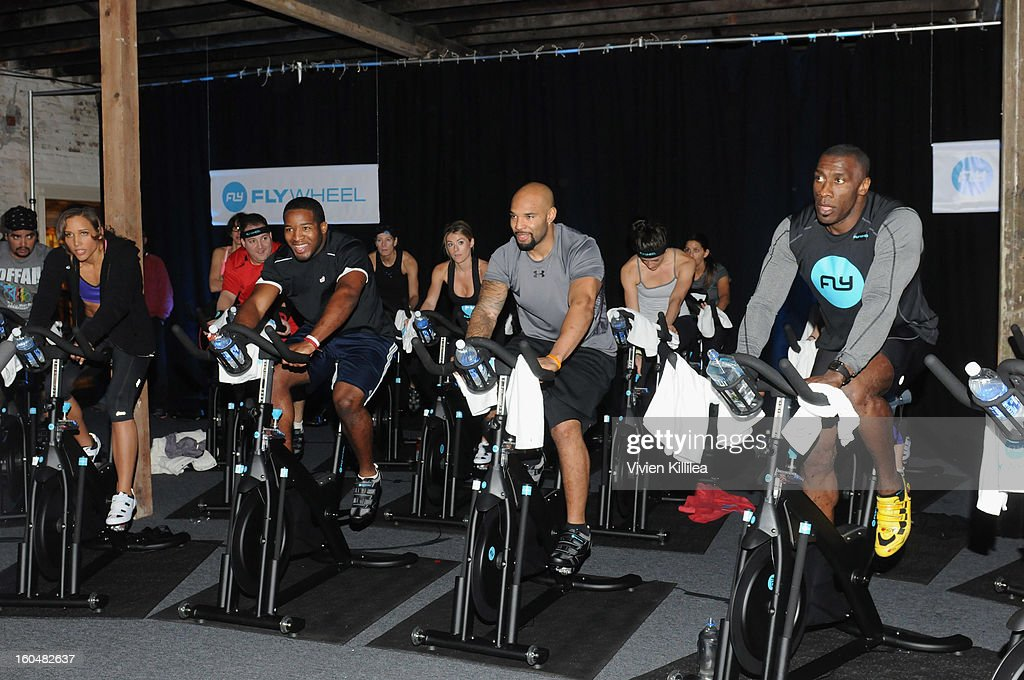 Olympian Lolo Jones, NFL players Alfred Morris, Matt Forte and former NFL player Shannon Sharpe attend The Flywheel Challenge at the NFL House hosted by Shannon Sharpe at The Chicory on February 1, 2013 in New Orleans, Louisiana.