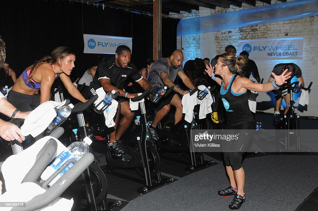 Olympian Lolo Jones, NFL players Alfred Morris, Matt Forte and trainer Holly Rilinger attend The Flywheel Challenge at the NFL House hosted by Shannon Sharpe at The Chicory on February 1, 2013 in New Orleans, Louisiana.