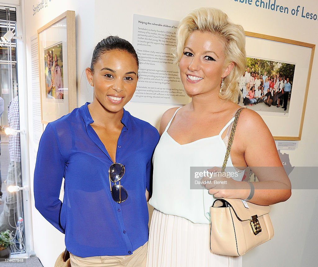 Olympian <a gi-track='captionPersonalityLinkClicked' href=/galleries/search?phrase=Louise+Hazel&family=editorial&specificpeople=1424099 ng-click='$event.stopPropagation()'>Louise Hazel</a> (L) and Natalie Coyle attend the private view of 'Sentebale - Stories Of Hope', showcasing images by Getty Images' Royal photographer Chris Jackson of Sentebale's work helping the vulnerable children of Lesotho, at the Getty Images Gallery on July 25, 2013 in London, England.