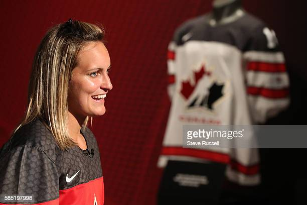 TORONTO ON AUGUST 2 Olympian MariePhilip Poulin is one of the first to sport the new Team Canada Jersey Rows of Maple Leaf icons fill the jersey's...