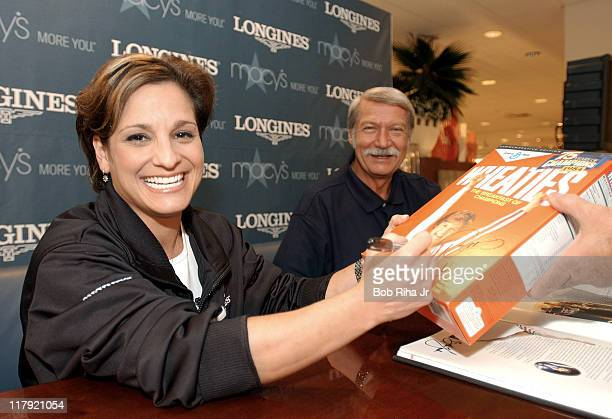 Olympian Mary Lou Retton an official with the 'Longines Perfect 10 Moments in Time' joined famed Olympic coach Bela Karolyi signing autographs for...