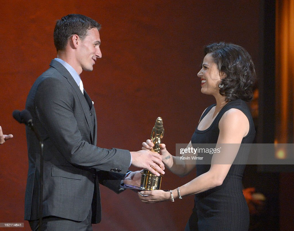 Olympian <a gi-track='captionPersonalityLinkClicked' href=/galleries/search?phrase=Ryan+Lochte&family=editorial&specificpeople=182557 ng-click='$event.stopPropagation()'>Ryan Lochte</a> (L) presents the Favorite TV Actress in a Drama to actress <a gi-track='captionPersonalityLinkClicked' href=/galleries/search?phrase=Lana+Parrilla&family=editorial&specificpeople=2303014 ng-click='$event.stopPropagation()'>Lana Parrilla</a> at the 2012 NCLR ALMA Awards at Pasadena Civic Auditorium on September 16, 2012 in Pasadena, California.