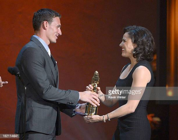 Olympian Ryan Lochte presents the Favorite TV Actress in a Drama to actress Lana Parrilla at the 2012 NCLR ALMA Awards at Pasadena Civic Auditorium...