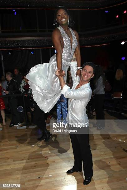 Olympian Simone Biles and dancer Sasha Farber attend 'Dancing with the Stars' Season 24 premiere at CBS Televison City on March 20 2017 in Los...