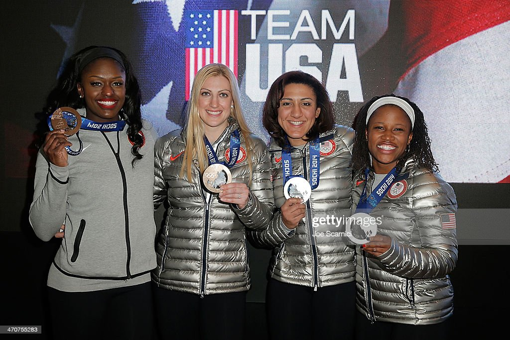 U.S. Olympians <a gi-track='captionPersonalityLinkClicked' href=/galleries/search?phrase=Aja+Evans&family=editorial&specificpeople=4068934 ng-click='$event.stopPropagation()'>Aja Evans</a> <a gi-track='captionPersonalityLinkClicked' href=/galleries/search?phrase=Jamie+Greubel&family=editorial&specificpeople=6680685 ng-click='$event.stopPropagation()'>Jamie Greubel</a>, <a gi-track='captionPersonalityLinkClicked' href=/galleries/search?phrase=Elana+Meyers&family=editorial&specificpeople=5631239 ng-click='$event.stopPropagation()'>Elana Meyers</a> and <a gi-track='captionPersonalityLinkClicked' href=/galleries/search?phrase=Lauryn+Williams&family=editorial&specificpeople=204367 ng-click='$event.stopPropagation()'>Lauryn Williams</a> visit the USA House in the Olympic Village on February 20, 2014 in Sochi, Russia.