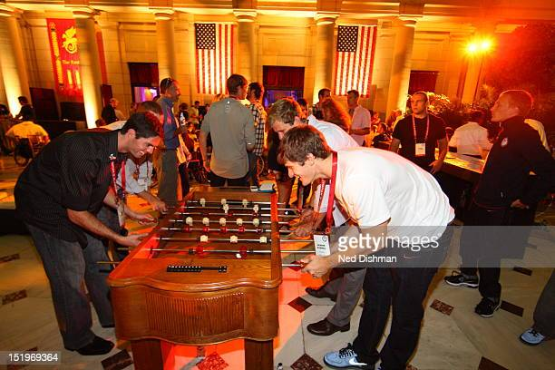 Olympians enjoying foosball during a USOC dinner saluting Olympians at Union Station on September 13 2012 in Washington DC